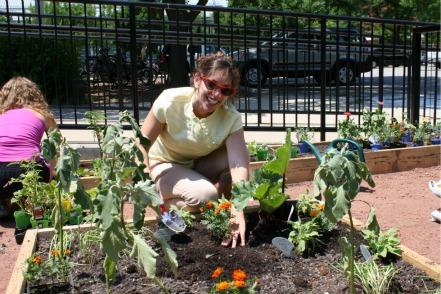 woman_with_plants_avant_garden.jpg